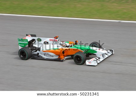 SEPANG, MALAYSIA - APRIL 4: German Adrian Sutil of Team Force India at top speed on the main straight at the Petronas Formula 1 Grand Prix April 4, 2010 in Sepang, Malaysia