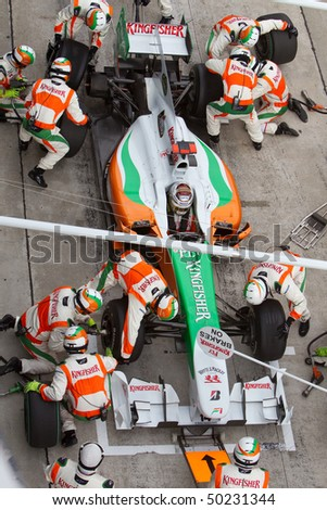 SEPANG, MALAYSIA - APRIL 4: German Adrian Sutil of Team Force India pitting for tires at the Petronas Formula 1 Grand Prix April 4, 2010 in Sepang, Malaysia - stock photo