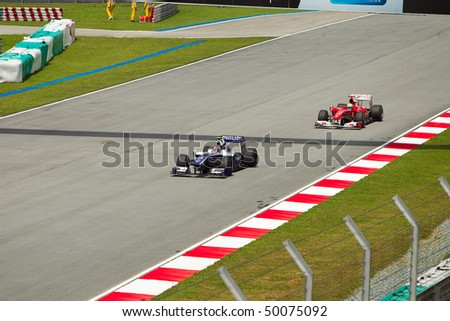SEPANG, MALAYSIA - APRIL 2: German Nico Hulkenberg of Team Williams pullis in front of Felipe Massa at the Petronas Formula 1 Grand Prix April 2, 2010 in Sepang, Malaysia