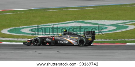 SEPANG, MALAYSIA - APRIL 2 : Hispania Racing F1 driver Bruno Senna of Brazil drives during Petronas Malaysian Grand Prix second practice session at Sepang F1 circuit April 2, 2010 in Sepang - stock photo