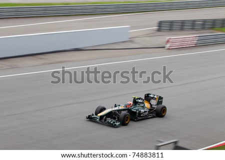 SEPANG, MALAYSIA - APRIL 8: Italian Jarno Trulli of Team Lotus at the backstraight during Friday practice at Petronas Formula 1 Grand Prix on April 8, 2011 in Sepang, Malaysia