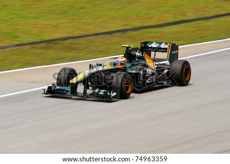 SEPANG, MALAYSIA - APRIL 8: Italian Jarno Trulli of Team Lotus at the backstraight during Friday practice at Petronas Formula 1 Grand Prix on April 8, 2011 in Sepang, Malaysia - stock photo