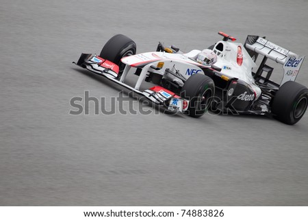 SEPANG, MALAYSIA - APRIL 8: Japanese Kamui Kobayashi of Sauber at the back straight during Friday practice at Petronas Formula 1 Grand Prix on April 8, 2011 in Sepang, Malaysia