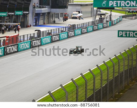 SEPANG, MALAYSIA - APRIL 8: Jarno Trulli (team Lotus) at first practice on Formula 1 GP, April 8 2011, Sepang, Malaysia - stock photo