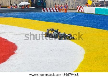 SEPANG, MALAYSIA - APRIL 10: Jarno Trulli (Team Lotus) at race of Formula 1 GP, April 10 2011, Sepang, Malaysia - stock photo