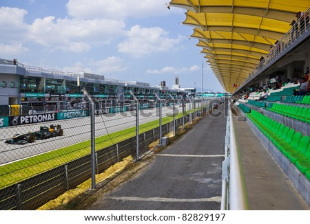 SEPANG, MALAYSIA - APRIL 8: Jarno Trulli (Team Lotus) at second practice on Formula 1 GP, April 8 2011, Sepang, Malaysia - stock photo