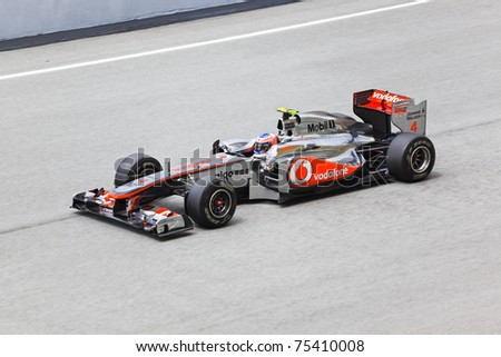 SEPANG, MALAYSIA - APRIL 8: Jenson Button (team Vodafone McLaren Mercedes) at first practice on Formula 1 GP, April 8 2011, Sepang, Malaysia - stock photo