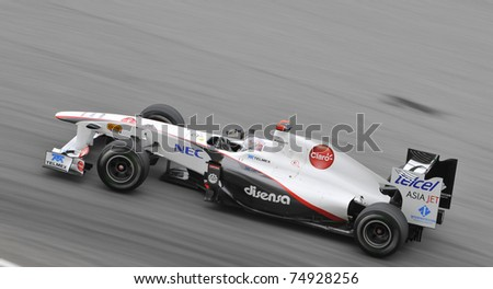 SEPANG, MALAYSIA - APRIL 8: Kamui Kobayashi of Sauber F1 Team during practice session at PETRONAS Malaysian GP on April 8, 2011 in Sepang, Malaysia. The race will be held on April 10 - stock photo