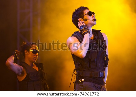 SEPANG, MALAYSIA - APRIL 10: Korean superstar Rain performs in a post F1 race concert at Petronas F1 Grand Prix Circuit April 10, 2011 in Sepang, Malaysia - stock photo