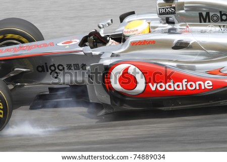 SEPANG, MALAYSIA - APRIL 8: Lewis Hamilton of Vodafone McLaren Mercedes brakes hard during PETRONAS Malaysian Grand Prix on April 8, 2011 in Sepang, Malaysia. The race will be held on April 10, 2011. - stock photo