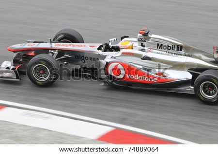 SEPANG, MALAYSIA - APRIL 8: Lewis Hamilton of Vodafone McLaren Mercedes in action at PETRONAS Malaysian Grand Prix on April 8, 2011 in Sepang, Malaysia. The race will be held on Sunday April 10, 2011. - stock photo