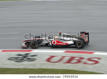 SEPANG, MALAYSIA - APRIL 8: Lewis Hamilton of Vodafone McLaren Mercedes in action at PETRONAS Malaysia Grand Prix on April 8, 2011 in Sepang, Malaysia. The race will be held on Sunday April 10, 2011. - stock photo