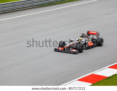 SEPANG, MALAYSIA - APRIL 8: Lewis Hamilton (team McLaren Mercedes) at first practice on Formula 1 GP, April 8 2011, Sepang, Malaysia - stock photo