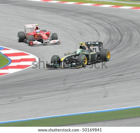 SEPANG, MALAYSIA - APRIL 2 : Lotus Racing driver Heikki Kovalainen of Finland drives during Petronas Malaysian Grand Prix second practice session at Sepang F1 circuit April 2, 2010 in Sepang - stock photo