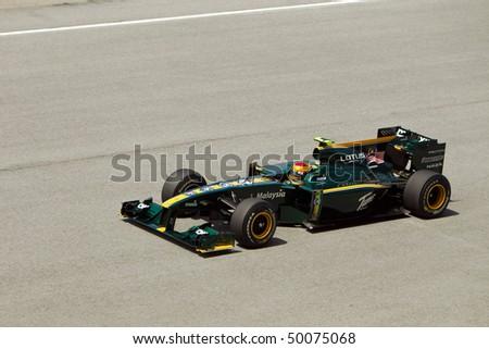SEPANG, MALAYSIA - APRIL 2: Malaysian Fairuz Fauzy of Team Lotus accelerates down the back straight at the Petronas Formula 1 Grand Prix April 2, 2010 in Sepang, Malaysia - stock photo