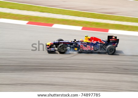 SEPANG, MALAYSIA- APRIL 8: Mark Webber of Red Bull Racing in action at PETRONAS Malaysia Grand Prix on April 8, 2011 in Sepang, Malaysia. Webber was fastest by a country mile in Practice One. - stock photo