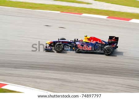 SEPANG, MALAYSIA- APRIL 8: Mark Webber of Red Bull Racing in action at PETRONAS Malaysia Grand Prix on April 8, 2011 in Sepang, Malaysia. The race will be held on Sunday April 10, 2011. - stock photo