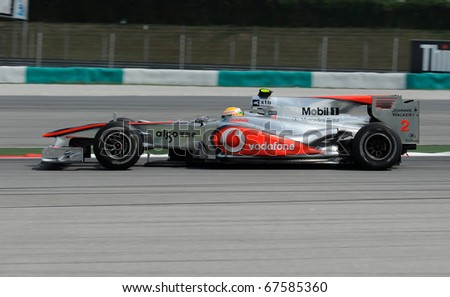 SEPANG, MALAYSIA - APRIL 2 : Mc Laren Racing Team Driver, Lewis Hamilton action on track in Petronas Formula One 2010 at Sepang circuit. April 2, 2010 in Sepang, Malaysia - stock photo