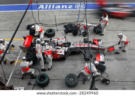 SEPANG, MALAYSIA - APRIL 5: McLaren Mercedes' Lewis Hamilton at a pit-stop of the final race of the 2009 F1 Petronas Malaysian Grand Prix. April 5, 2009 in Sepang Malaysia. - stock photo