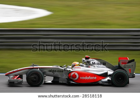 SEPANG, MALAYSIA - APRIL 4: McLaren Mercedes Lewis Hamilton on the tracks at the 2009 F1 Petronas Malaysian Grand Prix April 4, 2009 in Sepang Malaysia. Hamilton finished 7th on Sunday race day. - stock photo