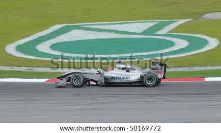 SEPANG, MALAYSIA - APRIL 2 : Mercedes Formula One driver Michael Schumacher of Germany drives during Petronas Malaysian Grand Prix second practice session at Sepang F1 circuit April 2, 2010 in Sepang - stock photo