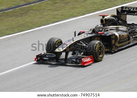SEPANG, MALAYSIA - APRIL 8: Nick Heidfeld of Lotus Renault GP during practice session at PETRONAS Malaysian GP on April 8, 2011 in Sepang, Malaysia. The race will be held on April 10 - stock photo