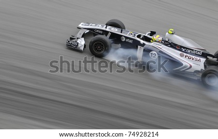 SEPANG, MALAYSIA - APRIL 8: Pastor Maldonado of AT&T Williams brakes hard during practice session at PETRONAS Malaysian GP on April 8, 2011 in Sepang, Malaysia. The race will be held on April 10 - stock photo
