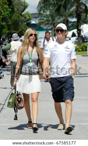 SEPANG, MALAYSIA - APRIL 4 : Petronas Mercedes F1 Team Driver, Nico Rosberg arrives with his girlfriend Vivian Sibold in Petronas Formula One 2010 at Sepang circuit. April 4, 2010 in Sepang, Malaysia