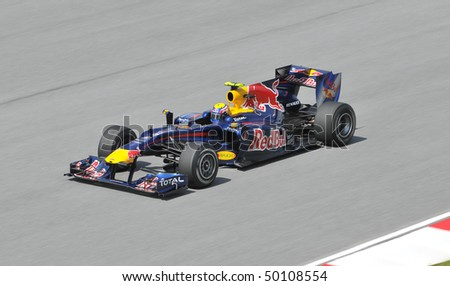 SEPANG, MALAYSIA - APRIL 2 : Red Bull Racing driver Mark Webber of Australia drives during the first practice session at the Sepang F1 circuit April 2, 2010 in Sepang. - stock photo