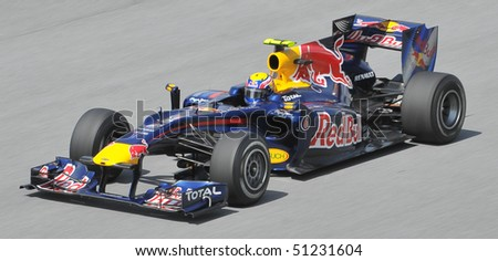 SEPANG, MALAYSIA - APRIL 2 : Red Bull Racing driver Mark Webber of Australia drives during the first practice session at the Sepang F1 circuit April 2, 2010 in Sepang, Malaysia. - stock photo