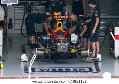 SEPANG, MALAYSIA - APRIL 8: Red Bull Racing's Mark Webber sees action on the first practice day of the Petronas Malaysian F1 Grand Prix on April 8, 2011 in Sepang, Malaysia. - stock photo
