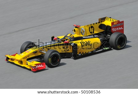 SEPANG, MALAYSIA - APRIL 2 : Renault F1 driver Robert Kubica of Poland drives during the first practice session at the Sepang F1 circuit April 2, 2010 in Sepang. - stock photo