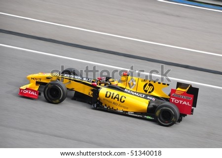 SEPANG, MALAYSIA - APRIL 4 : Renault F1 driver Robert Kubica of Poland speeding during the Formula 1 Petronas Malaysian Grand Prix at the Sepang F1 circuit April 4, 2010 in Sepang, Malaysia. - stock photo