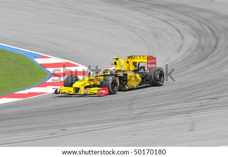 SEPANG, MALAYSIA - APRIL 2 : Renault F1 driver Vitaly Petrov of Russia drives during Petronas Malaysian Grand Prix second practice session at Sepang F1 circuit April 2, 2010 in Sepang - stock photo