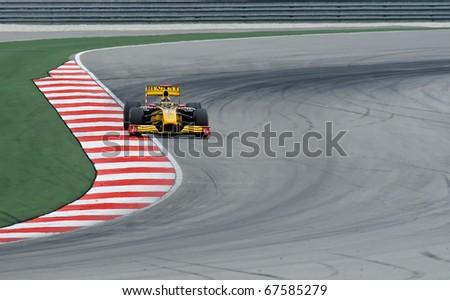 SEPANG, MALAYSIA - APRIL 2 : Renault Racing Team Driver, Robert Kubica action on track in Petronas Formula One 2010 at Sepang circuit. April 2, 2010 in Sepang, Malaysia - stock photo