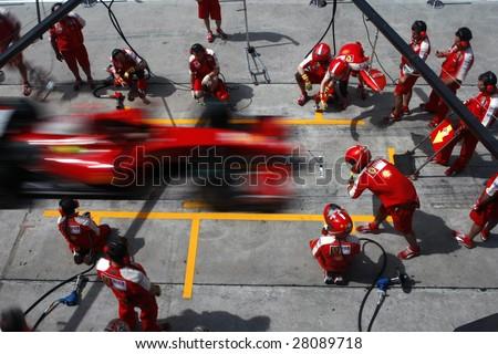 SEPANG, MALAYSIA - APRIL 4: Scuderia Ferrari Marlboro crews does pit-stop practice at the 2009 F1 Petronas Malaysian Grand Prix April 4, 2009 in Sepang Malaysia. - stock photo