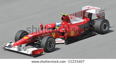 SEPANG, MALAYSIA - APRIL 2 : Scuderia Ferrari Marlboro driver Fernando Alonso of Spain drives during the first practice session at the Sepang F1 circuit April 2, 2010 in Sepang, Malaysia. - stock photo
