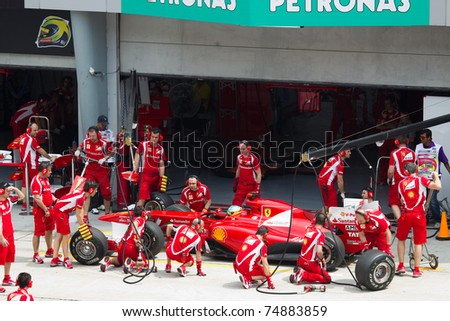 SEPANG, MALAYSIA - APRIL 8: Spanish Fernando Alonso of Scuderia Ferrari having a trial pitstop during Friday practice at Petronas Formula 1 Grand Prix on April 8, 2011 in Sepang, Malaysia - stock photo