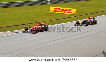 SEPANG, MALAYSIA - APRIL 8: Timo Glock and Sebastian Vettel at the back straight during Friday practice at the Petronas Formula 1 Grand Prix on April 8, 2011 in Sepang, Malaysia - stock photo