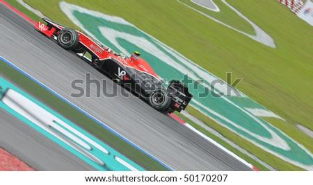 SEPANG, MALAYSIA - APRIL 2 : Virgin Racing driver Lucas di Grassi of Brazil drives during Petronas Malaysian Grand Prix second practice session at Sepang F1 circuit April 2, 2010 in Sepang - stock photo