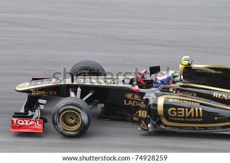 SEPANG, MALAYSIA - APRIL 8: Vitaly Petrov of Lotus Renault GP during practice session at PETRONAS Malaysian GP on April 8, 2011 in Sepang, Malaysia. The race will be held on April 10 - stock photo