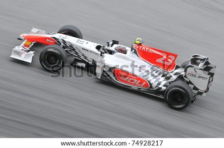 SEPANG, MALAYSIA - APRIL 8: Vitantonio Liuzzi of HRT Hispania Racing F1 Team during practice session at PETRONAS Malaysia GP on April 8, 2011 in Sepang, Malaysia. The race will be held on April 10 - stock photo