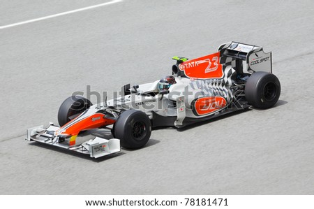 SEPANG, MALAYSIA - APRIL 8: Vitantonio Liuzzi (team Hispania Racing) at first practice  at the Formula 1 GP on April 8 2011 in Sepang, Malaysia - stock photo