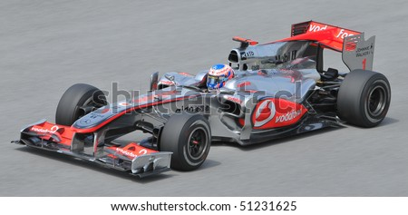 SEPANG, MALAYSIA - APRIL 2 : Vodafone McLaren Mercedes driver Jenson Button of Great Britain drives during the first practice session at the Sepang F1 circuit April 2, 2010 in Sepang, Malaysia. - stock photo