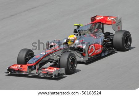 SEPANG, MALAYSIA - APRIL 2 : Vodafone McLaren Mercedes driver Lewis Hamilton of Great Britain drives during the first practice session at the Sepang F1 circuit April 2, 2010 in Sepang. - stock photo