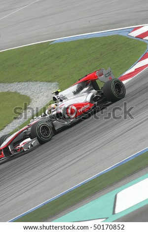 SEPANG, MALAYSIA -APRIL 2:Vodafone McLaren Mercedes driver Lewis Hamilton of Great Britain drives during Petronas Malaysian Grand Prix 2nd practice session at Sepang F1 circuit April 2, 2010 in Sepang