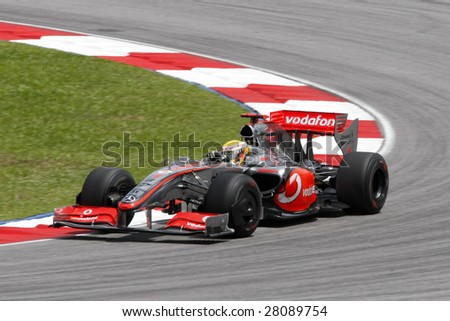 SEPANG, MALAYSIA - APRIL 4: Vodafone McLaren Mercedes Lewis Hamilton does a practice run at the 2009 F1 Petronas Malaysian Grand Prix April 4, 2009 in Sepang, Malaysia. - stock photo