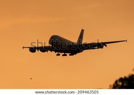 SEPANG, MALAYSIA - AUGT 4: Airbus A380 registered with number 9M-MNB owned by Malaysia Airlines approach to landing at Kuala Lumpur International Air Port, Sepang, Malaysia on August 4, 2014. - stock photo