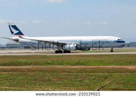 SEPANG, MALAYSIA - AUGUST 5: Cathay Pacific plane Airbus A330-343X, Registration name B-LAP, take-off at KLIA airport on August 5, 2014 in KLIA, Sepang, Malaysia.  - stock photo