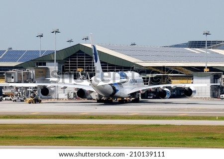 SEPANG, MALAYSIA - AUGUST 5: Malaysia Airline plane Airbus A380-841, Registration name 9M-MNA, at KLIA airport on August 5, 2014 in KLIA, Sepang, Malaysia.  - stock photo